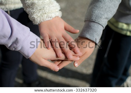 Kids holding hands together. Every kid took his hand and put on another kids hand.