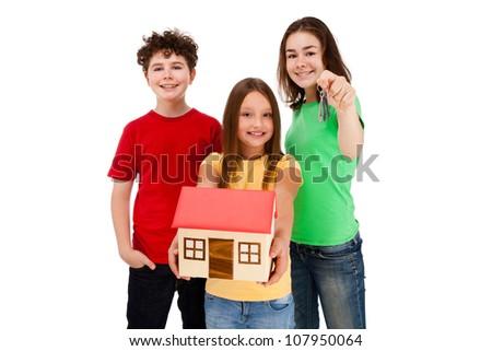 Kids holding model of house isolated on white - stock photo