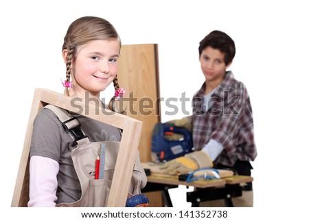 kids in a craftsman workshop - stock photo