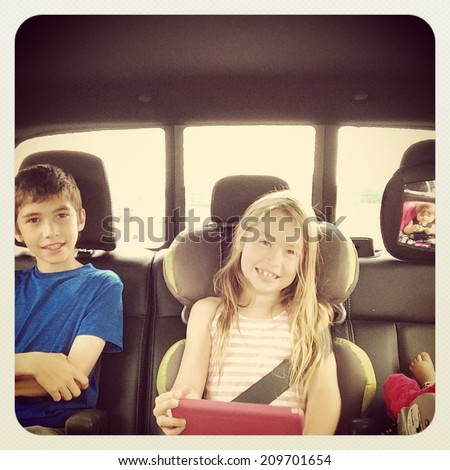 Kids in back of truck going on a trip - With Instagram effect - stock photo