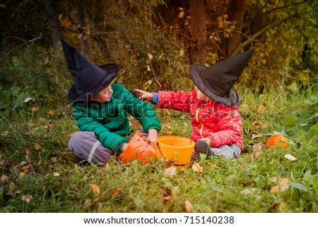 kids in halloween costume play at autumn trick or treating