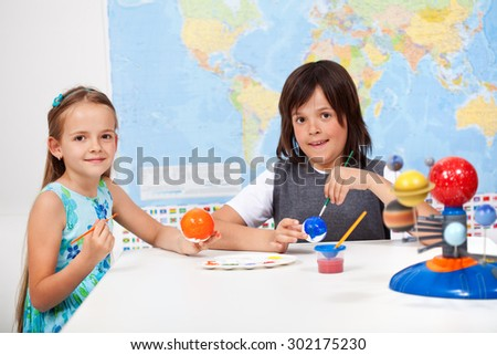 Kids in science and arts class -focus on girl face - stock photo