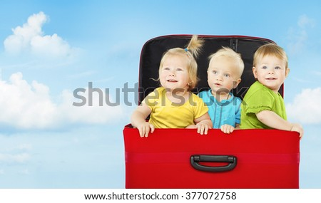 Kids in Suitcase, Three Happy Children Playing and Looking Up on Blue Sky - stock photo