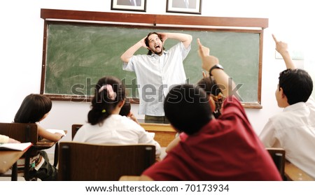 kids in the school, classroom with a mad crazy silly teacher yelling in front of the class because of them - stock photo