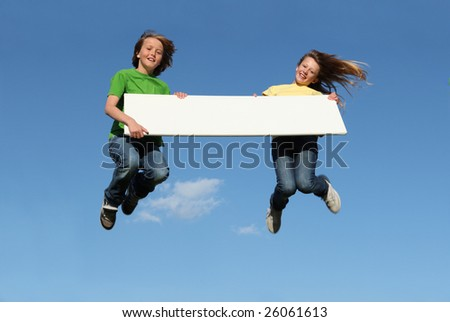 kids jumping with blank board - stock photo