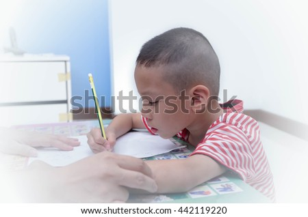Kids leaning with mom at home,Attention Deficit Hyperactivity Di - stock photo