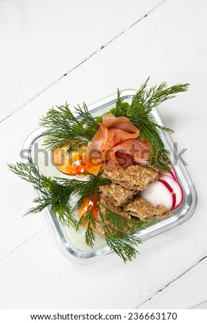 Kids lunch box: salted salmon, egg, radish, rye bread and dill - stock photo