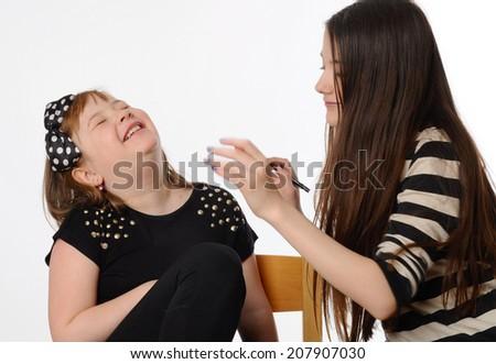 Kids make-up on white background - stock photo