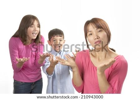 Kids nagging mom. - stock photo
