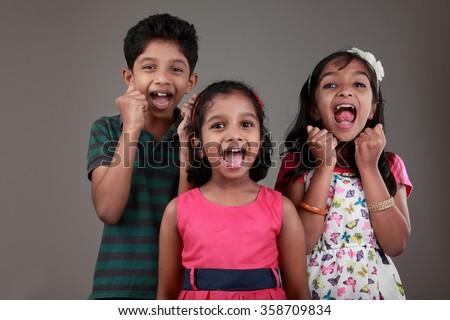Kids of Indian origin cheering up - stock photo
