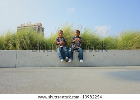 Kids on a Ledge - stock photo