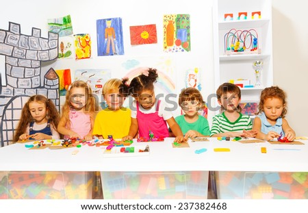 Kids on developing class play with plasticine - stock photo