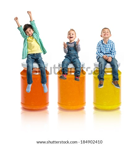 Kids on three bottle of jam over white background  - stock photo