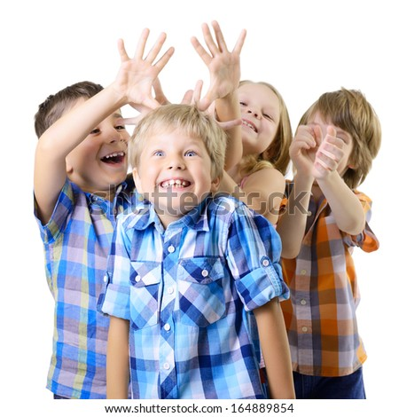 Kids play and have fun together. Children playing over white background - stock photo