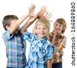 Kids play and have fun together. Little boys playing over white background - stock photo