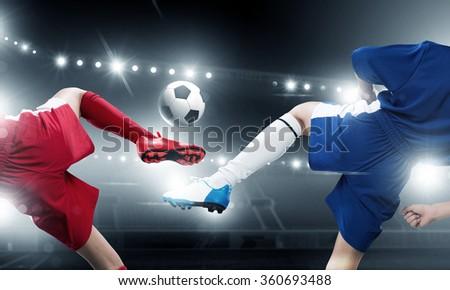 Kids play soccer on stadium  - stock photo