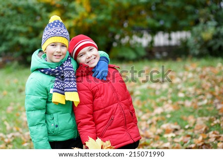 Kids playing in autumn park - stock photo