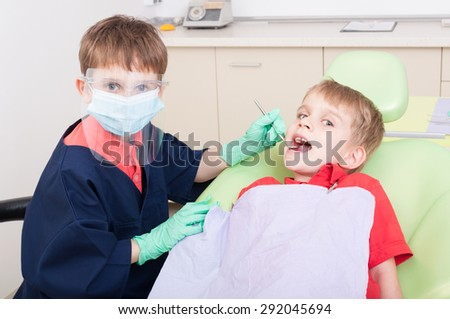 Kids playing in dental office. No fear of dentist concept - stock photo
