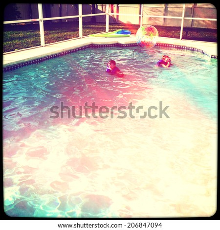 Kids playing in swimming pool with instagram effect - stock photo