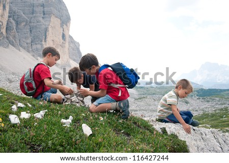 Kids playing in the mountains. Dolomites, Italy. - stock photo