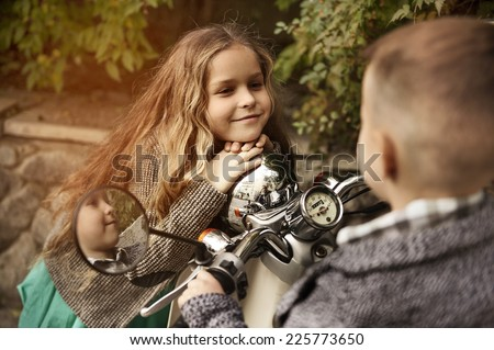 kids playing love on scooter, - stock photo