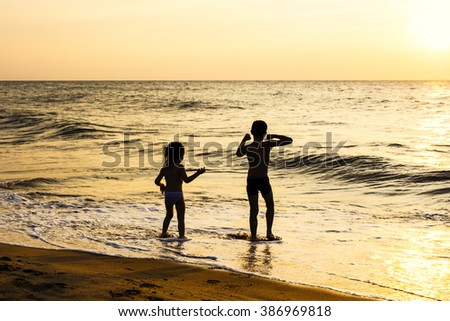 Kids playing on the beach. Exotic, tropical destinations.