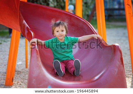Kids, playing on the playground, having fun