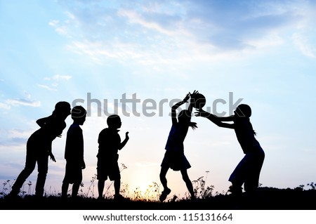Kids playing outdoors with ball - stock photo