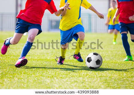 Kids Playing Soccer Football Match. Sport Soccer Tournament for Youth Teams. - stock photo