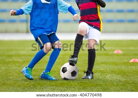 Kids Playing Soccer Football. Soccer Match of Youth Teams. Football Tournament Competition. - stock photo