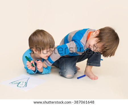 Kids playing, tickling, having fun, laughing and giggling - stock photo
