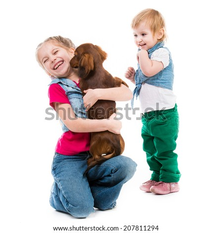 kids playing with a red dachshund isolatad on white background - stock photo