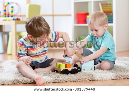 kids playing with crane car toy together