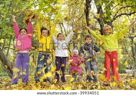 kids  playing with leaves - stock photo