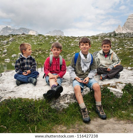 Kids portrait in the mountains. Dolomites, Italy.