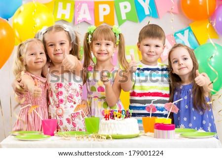 kids preschoolers celebrating birthday party - stock photo