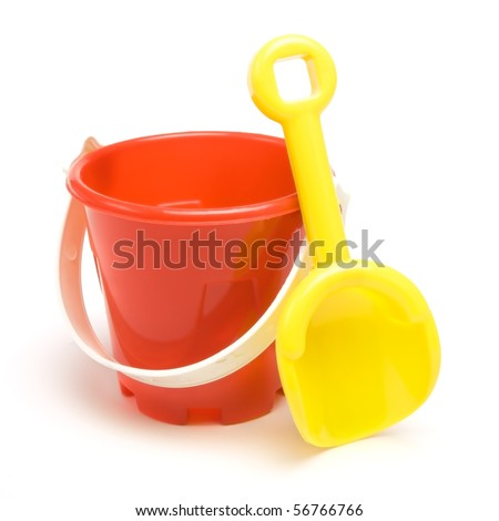 Kids red bucket and yellow spade summer holiday concept isolated against white background. - stock photo