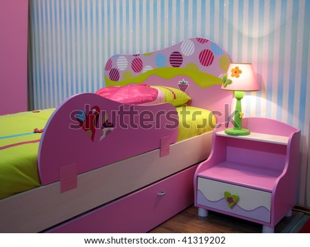 kids room with baby bed. pink baby bed and night locker.