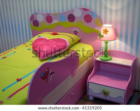 kids room with baby bed. pink baby bed and night locker. Pink bedside table. - stock photo
