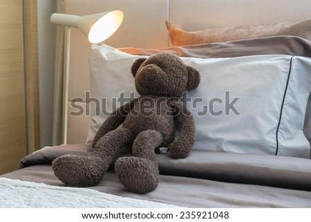 kids room with doll and pillows on bed at home - stock photo