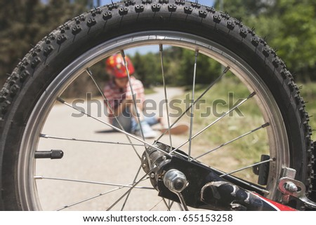 Kids safety concept. Bicycle accident. (Selective focus image)