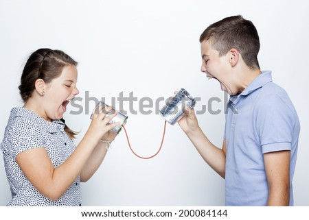 Kids screaming to a can against gray background - stock photo