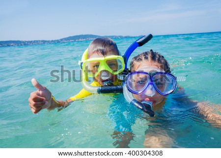 Kids scuba diving - stock photo