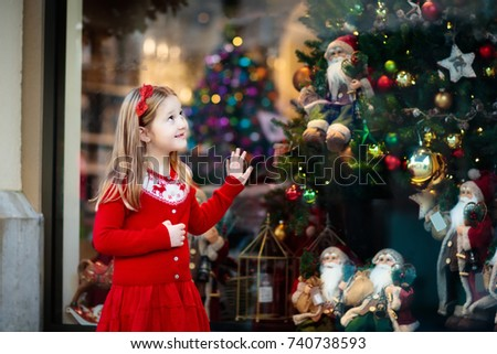 kids shopping for christmas presents children buy xmas decoration and tree little girl at - What To Buy A Girl For Christmas