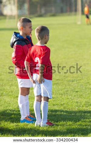 Kids soccer as a substitution - stock photo