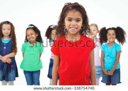 Kids standing together with girl in front against a white background