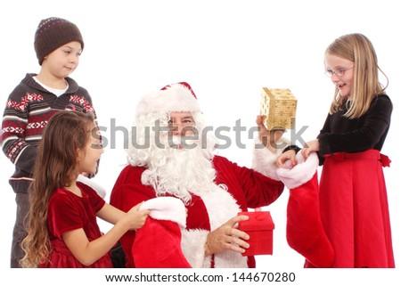 Kids talk with Santa - stock photo