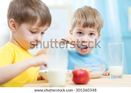 kids toddlers eating healthy food at home or kindergarten - stock photo