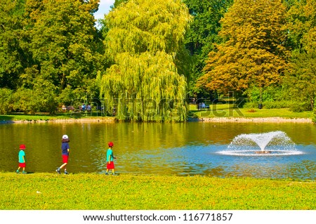 Kids walking at fountain in park
