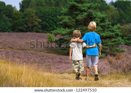 kids walking on heathland - stock photo
